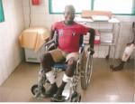 2013 léproserie Davougon - un des malades en fauteuil roulant.jpg